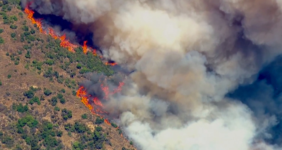 2 big wildfires in LA-area foothills burn toward each other