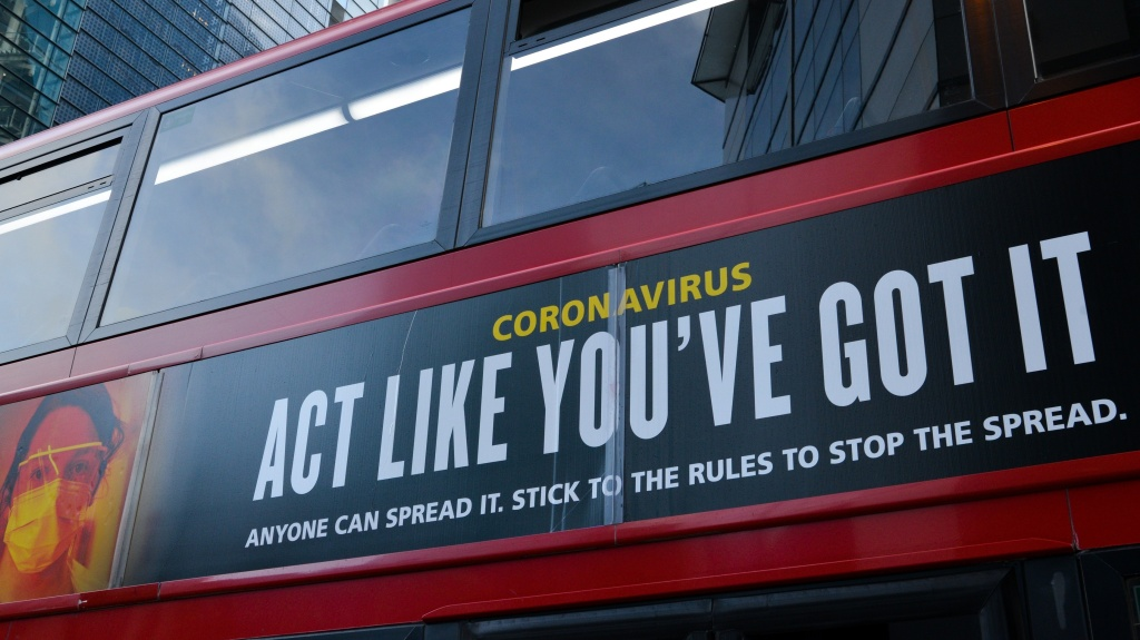 Moderna will test new COVID-19 vaccine boosters, saying that while its vaccine should protect against variants found in the U.K. and South Africa, it isn't as effective against one strain.  Here, a bus in London carries a sign telling people,