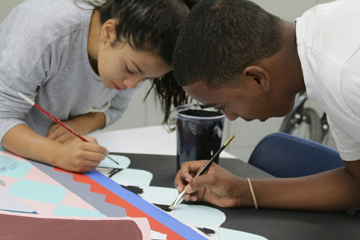Dalon Poole (right) works on a mural project at the La Pintoresca Teen Education Center in Pasadena.