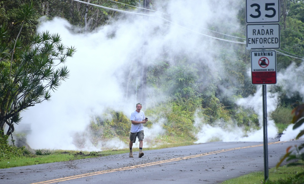 A man walks away as steam rises from a fissure at the Leilani Estates subdivision near the town of Pahoa on Hawaii's Big Island on May 4, 2018.