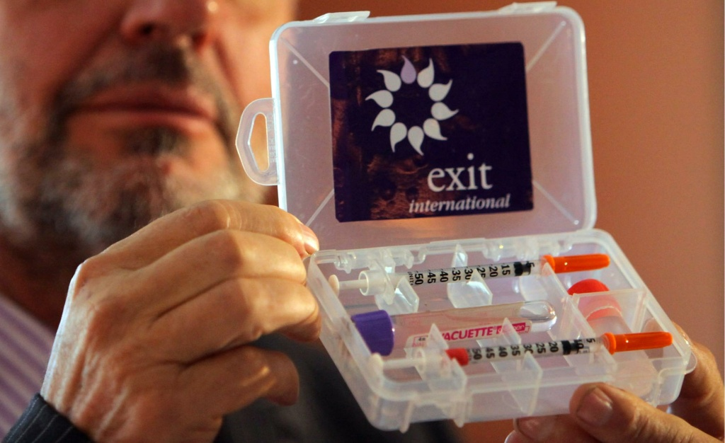 Dr Philip Nitschke holds up a drug testing kit which is used as part of assisted suicides following a workshop on the subject on May 5, 2009 in Bournemouth, England.