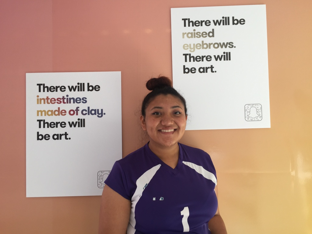 Manual Arts senior Kimberly Gonzalez, who said she loves to draw, tried creative writing while at the kickoff event.