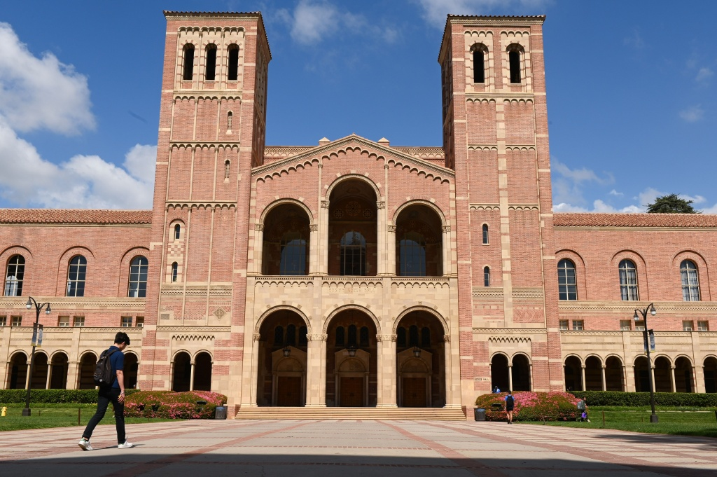 A student walks toward Royce Hall on the campus of University of California at Los Angeles (UCLA) in Los Angeles, California on March 11, 2020.