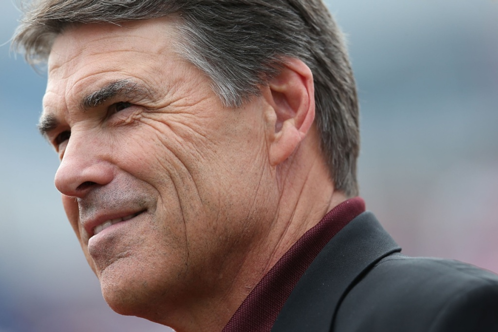 Texas Gov. Rick Perry attends a game between the Texas A&M Aggies and the Southern Methodist Mustangs at Gerald J. Ford Stadium.