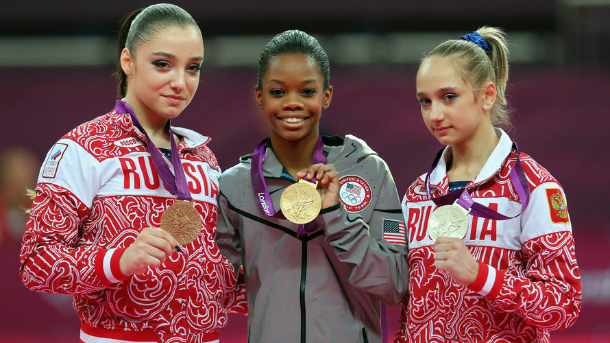 Researchers studied photos of Olympic medalists to learn who is the happiest. Here, bronze medalist Aliya Mustafina of Russia, gold medalist Gabby Douglas of the U.S., and silver medalist Victoria Komova of Russia pose after the all-around gymnastics final.