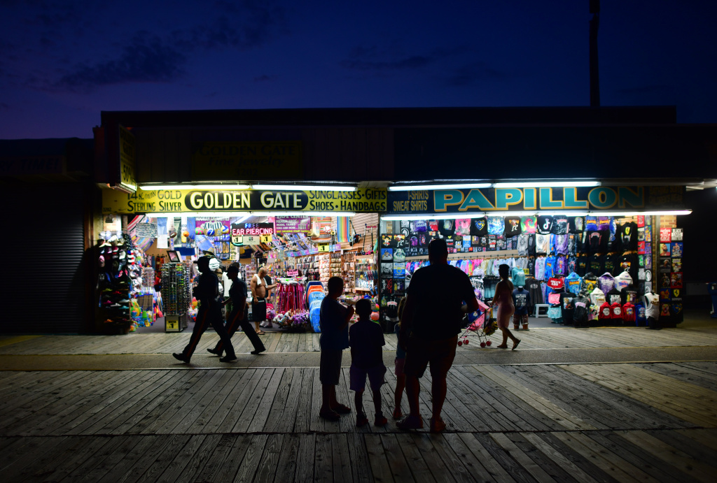 People walk the boardwalk on July 3 in Wildwood, New Jersey, after some coronavirus restrictions were lifted. There's concern that case counts could push back up in Mid-Atlantic and Northeastern states.