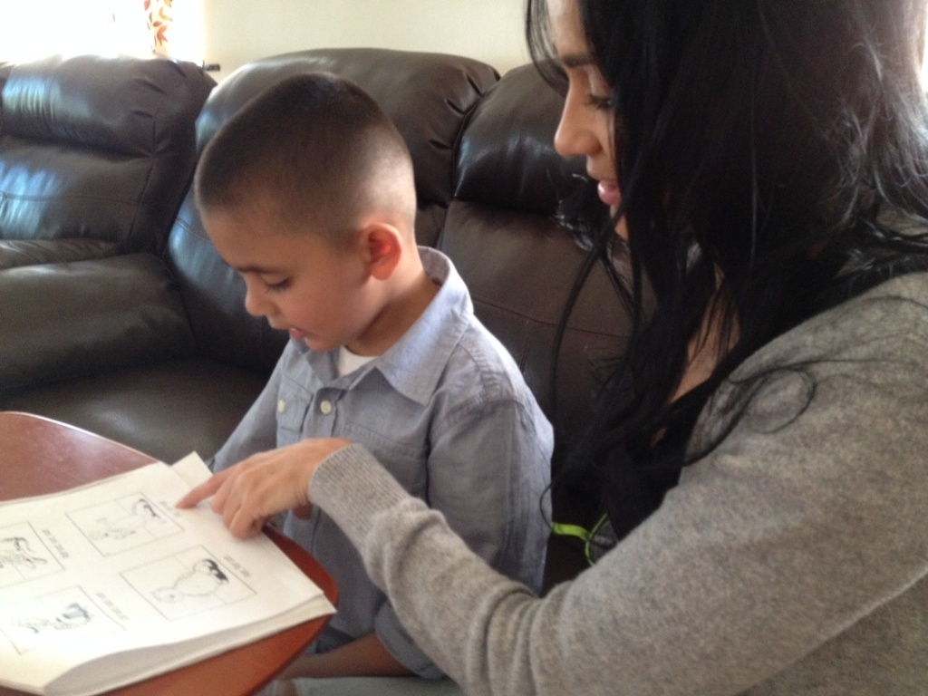 Blanca Romero does a reading exercise with Jayden, her 4-year old son. Jayden attends El Sereno Elementary's state PreK program. His mother loves the program, even though it is only for 3 hours per day.