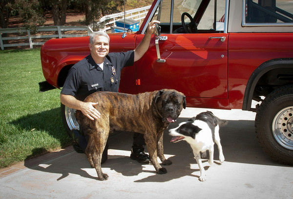 LAPD Chief Charlie Beck with his wife and rescue dog, Handsome.