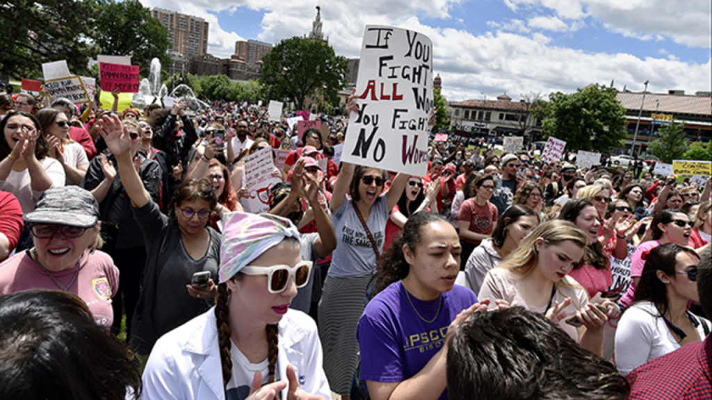 Several hundred spirited protesters marched through the Country Club Plaza Sunday, May 19, 2019, in response to the near-total abortion ban passed last week by Missouri legislators.