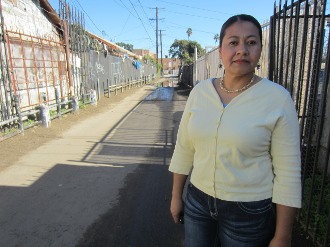 Sofía Girón uses the alleys in her South L.A. neighborhood as a shortcut. She stands in one of the sections that will be renovated as part of the pilot project.