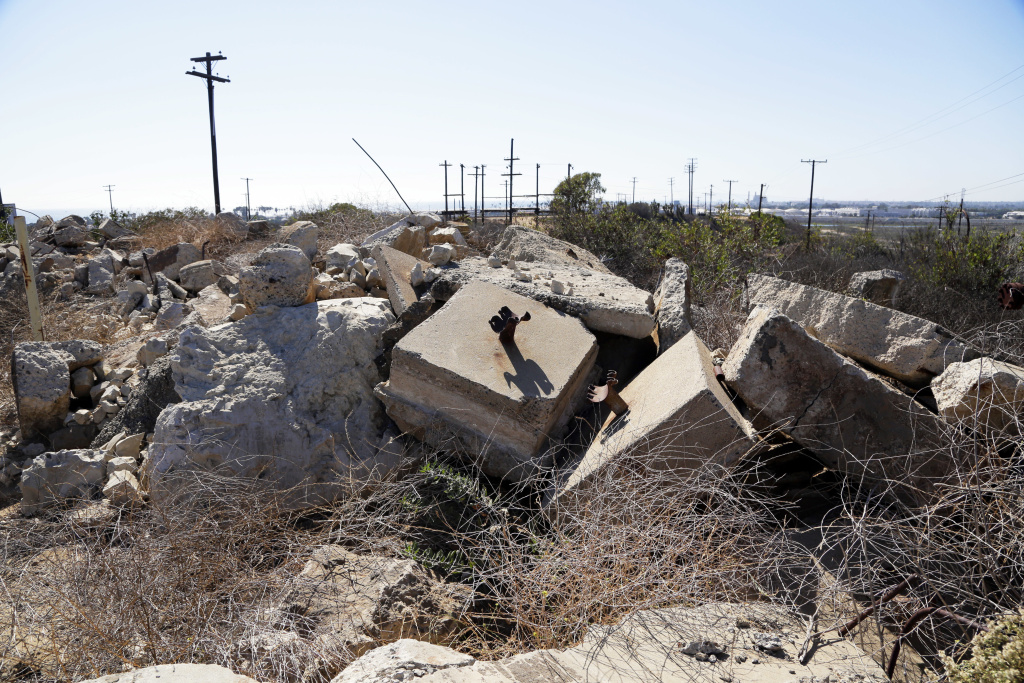 This Aug. 18, 2016 photo shows debris from an oil-extraction operation on Banning Ranch, a 401-acre swath of land in Newport Beach. In late February, California's Division of Oil, Gas and Geothermal Resources issued citations including some 150 violations to two oil firms with leases on the land.