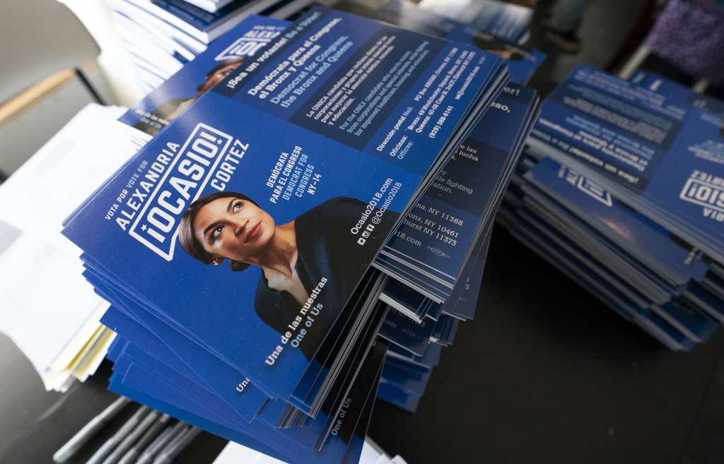 Campaign brochures about progressive democratic congressional candidate Alexandria Ocasio-Cortez are on hand for her general campaign kick-off rally on September 22, 2018 in the Bronx borough of New York.