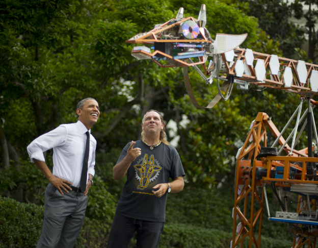 President Barack Obama meets Lindsay Lawlor of San Diego, Calif., and his creation, a 17-foot-tall, 2,200-lb robotic giraffe that