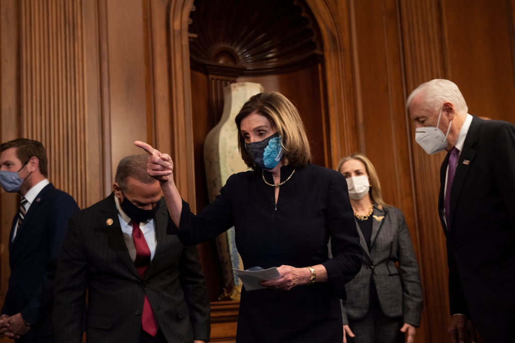 Speaker of the House Nancy Pelosi (D-CA) (C) arrives with Democratic leadership and impeachment managers to sign an article of impeachment during an engrossment ceremony on Capitol Hill charging US President Donald Trump with