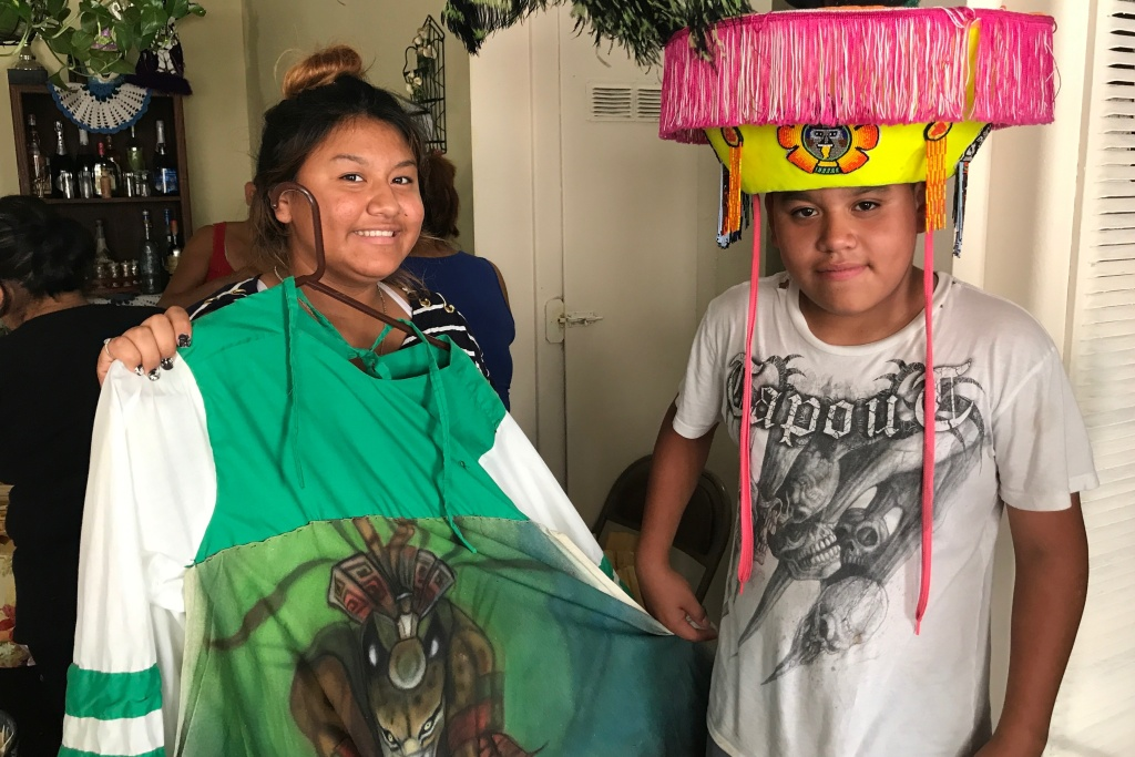 Brother and sister Prisila and Rey López show off Rey's Chinelos costume. The centuries-old Chinelos dance started as a veiled way for the indigenous and mestizo people of Mexico to mock the Spanish colonists, July 27, 2017.
