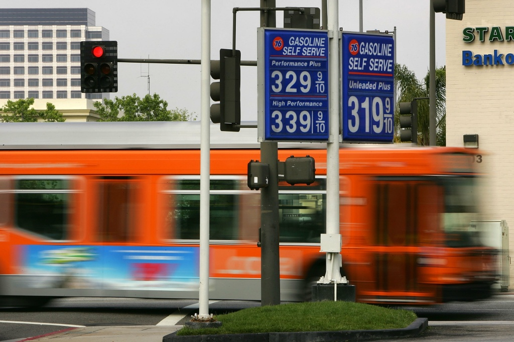 A public transit bus passes a gas station in the Los Angeles area city of Glendale, California.