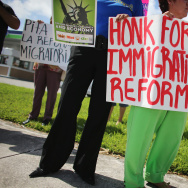 Protesters stand together as they hold a protest to ask their congress people to make immigration reform a reality on August 16, 2013 in Miami, Florida. President Obama indicated last month that he would take some sort of executive action on immigration after the midterm elections. But some observers think he may wait longer, depending on election outcomes.
