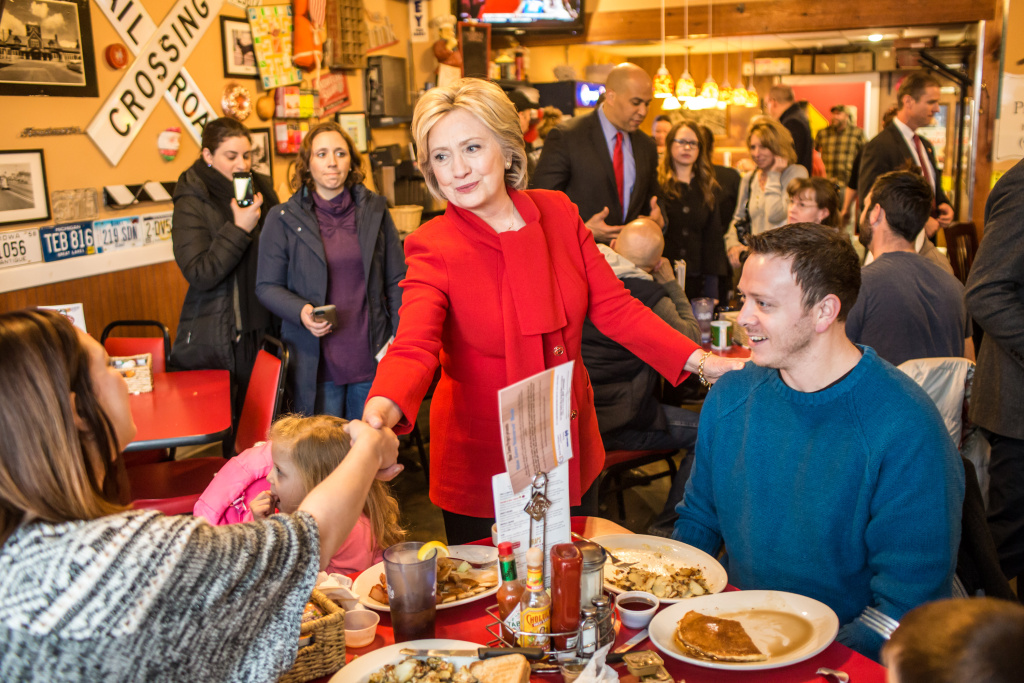 Democratic presidential candidate Hillary Clinton (C) greets diners at Riley's Cafe on January 24, 2016 in Cedar Rapids, Iowa.