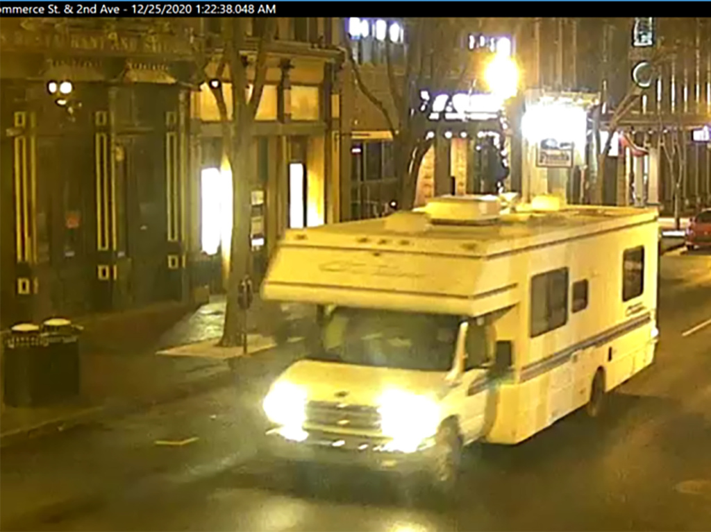 A screengrab of surveillance footage shows the recreational vehicle used in the Christmas day bombing in Nashville, Tennessee. The girlfriend of the man who carried out the attack says she warned police in August of last year that he was making bombs in his RV.