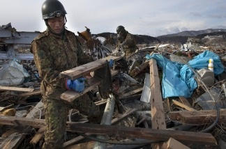 Members of Japan's Self-Defense force clear debris as they continue searching for bodies on March 17, 2011 in Minamisanriku, Japan.