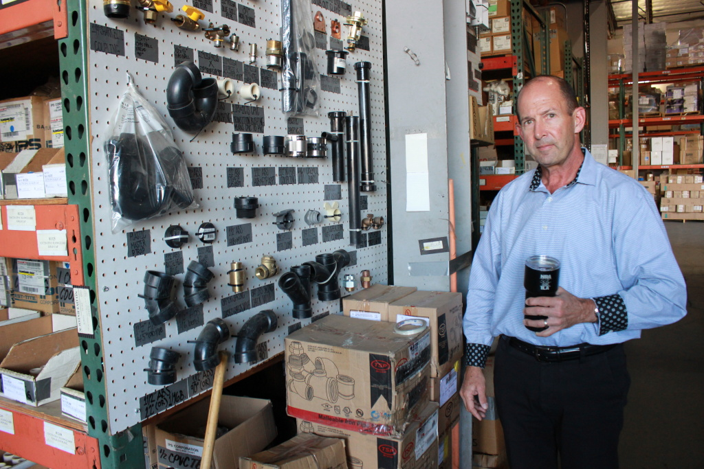 20/20 Plumbing and Heating vice president Mike Mahony walks through the company's warehouse, October 16, 2019.
