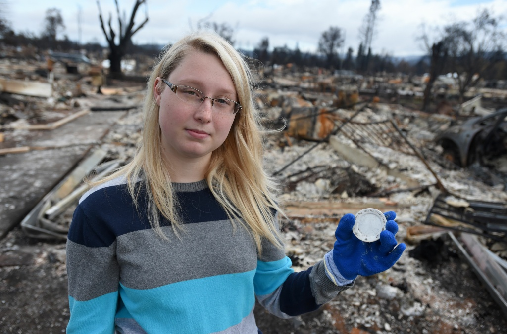 Kassidy Sharp holds part of a tea set given to her by her grandmother and found in the burned remains of her home in Santa Rosa, California on October 20, 2017.  The tea set read