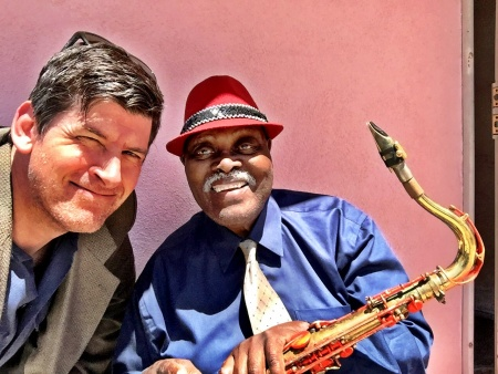 Off-Ramp host John Rabe with 90-year old sax legend Big Jay McNeely outside McNeely's home in South LA.
