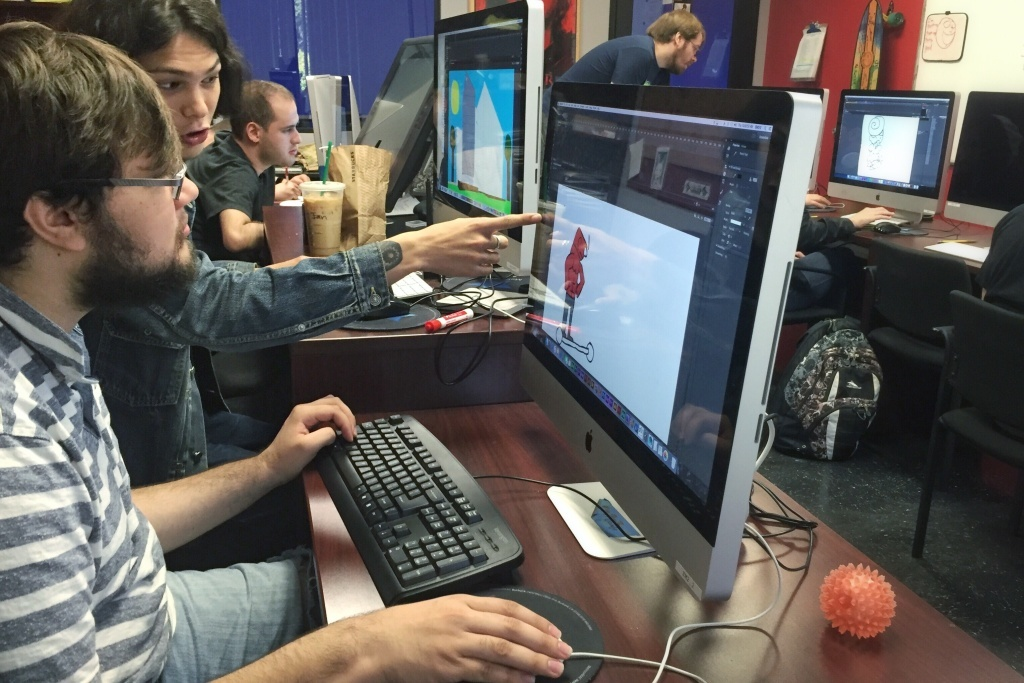 Instructor Ian Anderson guides Carlos Sanchez, a student in an animation class at Exceptional Minds.