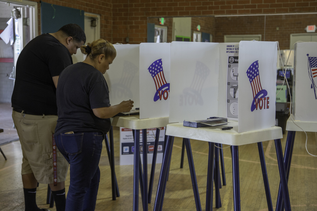 FILE: Residents in Los Angeles' Boyle Heights neighborhood vote in the primary election on Tuesday, June 5, 2018.