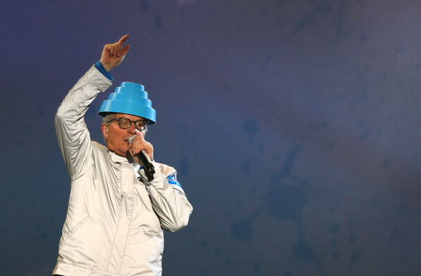 Mark Mothersbaugh of Devo performs at the medal ceremony at the 2010 Winter Olympics in Vancouver.