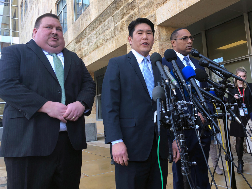 U.S. Attorney Robert Hur (center) discusses the charges against Christopher Hasson with Art Walker (left) of the Coast Guard investigative service, and FBI special agent Gordon Johnson last month.