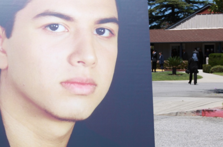 Photo of 19 year old Abdul Arian stands outside his memorial service at Valhalla Memorial Park. Arian was shot to death by LAPD after he led them on a high speed chase and reportedly told 911 he was armed.