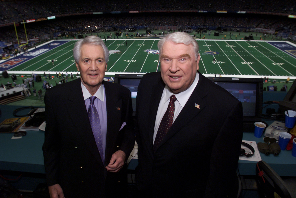 Pat Summerall (left) and John Madden in the broadcast booth together for the last time at Super Bowl XXXVI at the Louisiana Superdome in New Orleans.
