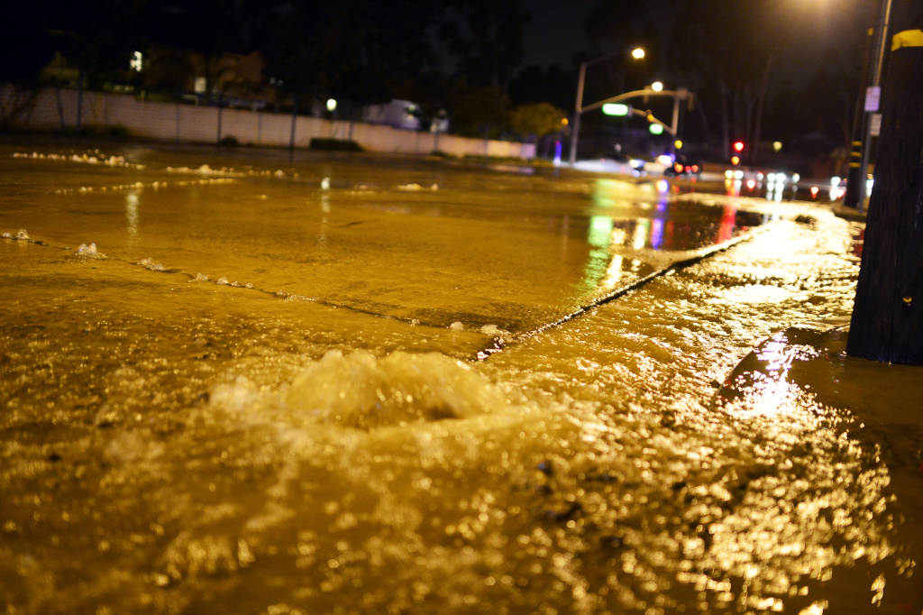 Flooded North Gilbert St in Fullerton after a 5.1 magnitude earthquake burst a water main Friday evening March 28, 2014.
