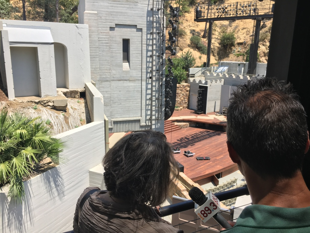 A Martinez and Brenda Levin survey the stage from the catwalk at the Ford Amphitheatre.