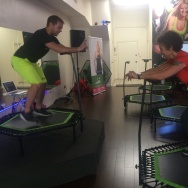 Jumping Fitness instructor Jakub Novotny helps Take Two's Alex Cohen try out trampoline fitness.