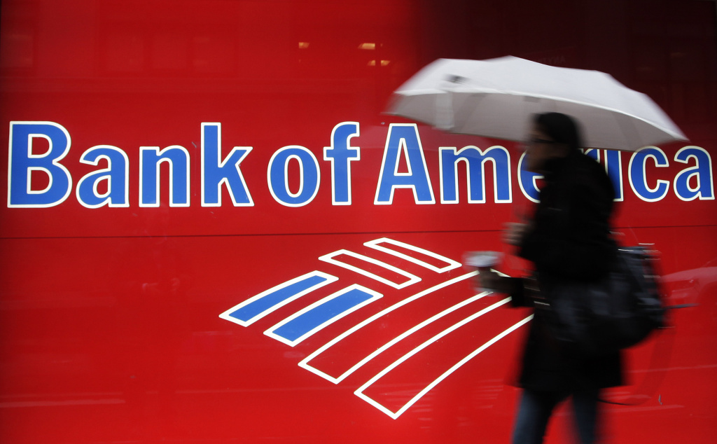In this Dec. 7, 2011 file photo, a woman passes a Bank of America office branch, in New York. A New York judge on Friday approved most of an $8.5 billion Bank of America settlement over investor losses from mortgage-backed securities.