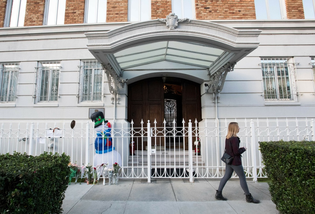 A woman walks passed the entrance to the Consulate-General of Russia building in San Francisco, California on December 29, 2016.