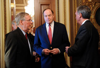 US Senate Minority Leader Mitch McConnell (L), R-KY, talks with Senator Richard Shelby (C), R-AL, and Senator Jud Gregg (R), R-NH, as they leave the closed door meeting of the Senate Republican Caucus on April 28, 2010 on Capitol Hill in Washington, DC.