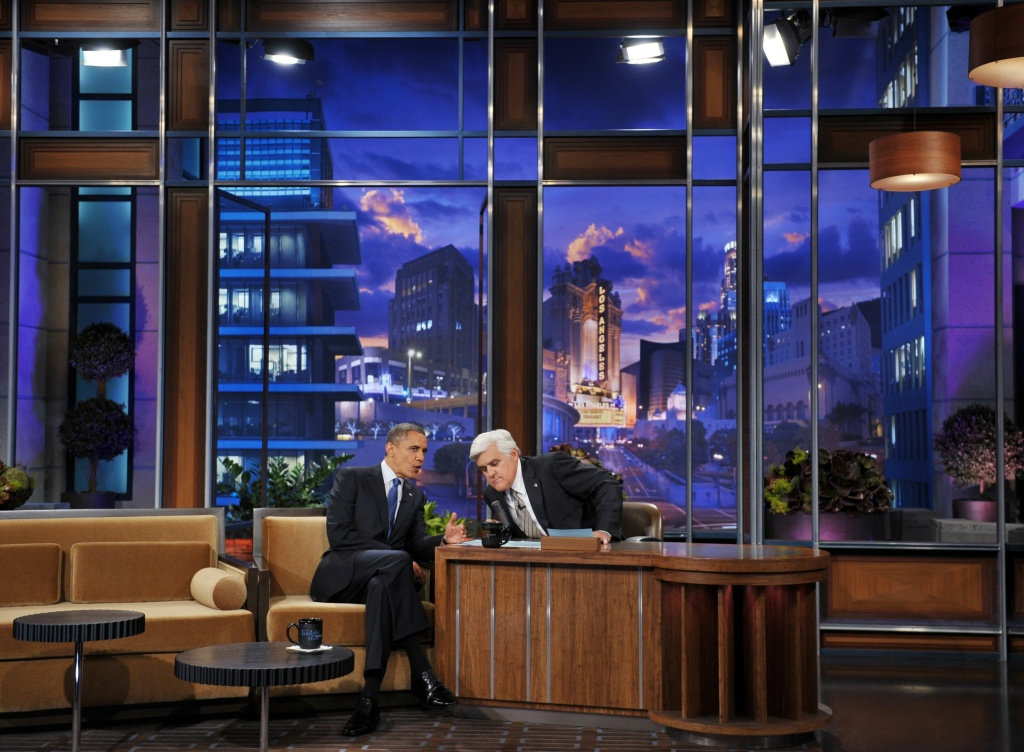 "US President Barack Obama chats with host Jay Leno during a break in the taping of ""The Tonight Show with Jay Leno"" October 24, 2012 at NBC Studios in Burbank, California."