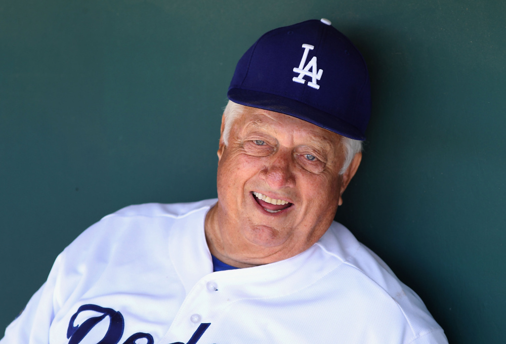 Former manager Tommy Lasorda of the Los Angeles Dodgers sits in the dugout during the spring training game against the Milwaukee Brewers at Camelback Ranch on March 30, 2012 in Glendale, Arizona.