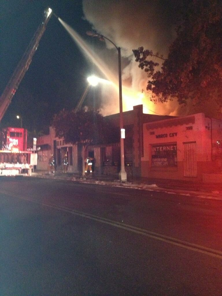 The Pasadena Fire Department tweeted out an image of the fire that burned several buildings along Fair Oaks Avenue early Sunday morning.