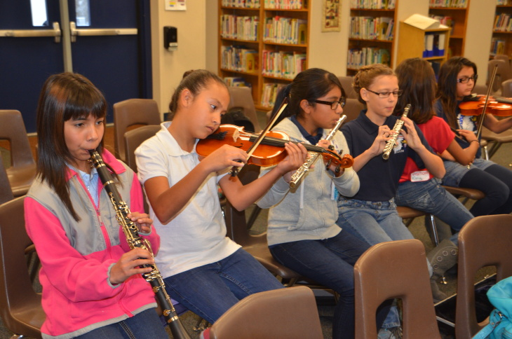 Anaheim City School District elementary students test out their instruments. Organizers of the new orchestra program estimate that the district still needs about 700 instruments to be fully stocked.