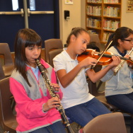A group of students at Anaheim City School District practice music during the district's new after-school orchestra program. Until 2013, school officials say the district didn't own a single musical instrument.