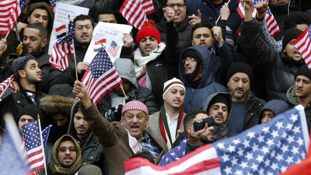 FILE: Muslims and supporters gather on the steps of Borough Hall in Brooklyn, New York, during a protest in February against President Trump's temporary travel ban.