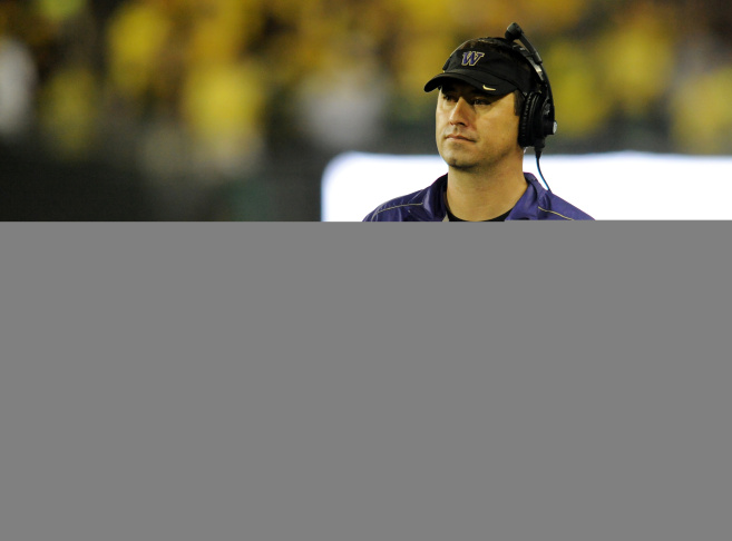 Huskies gead coach Steve Sarkisian looks out from the bench during the third quarter of the game on October 6, 2012 at Autzen Stadium in Eugene, Oregon.