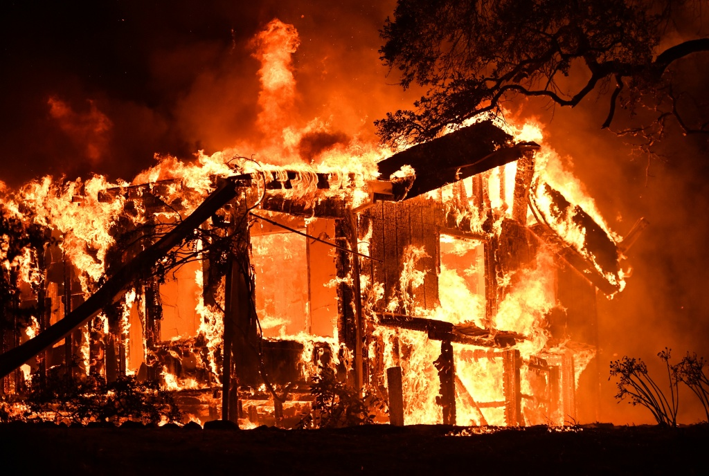 Flames ravage a home in the Napa wine region in California on Oct. 9, 2017, as multiple wind-driven fires continue to whip through the region.