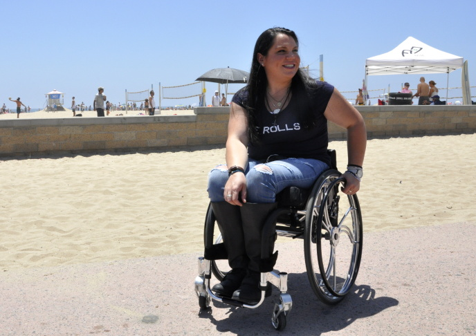 Tiffany Giddes has been in a wheelchair for 11 years after she was injured in a car accident. She said she has no feeling below her knees.