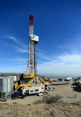 Crews from SoCalGas and outside experts work on a relief well at the Aliso Canyon facility above Porter Ranch on Dec. 9, 2015. Once the relief well is connected to the leaking well, SoCalGas will pump fluids and cement into the bottom of the leaking well to stop the flow of gas and permanently seal the well.