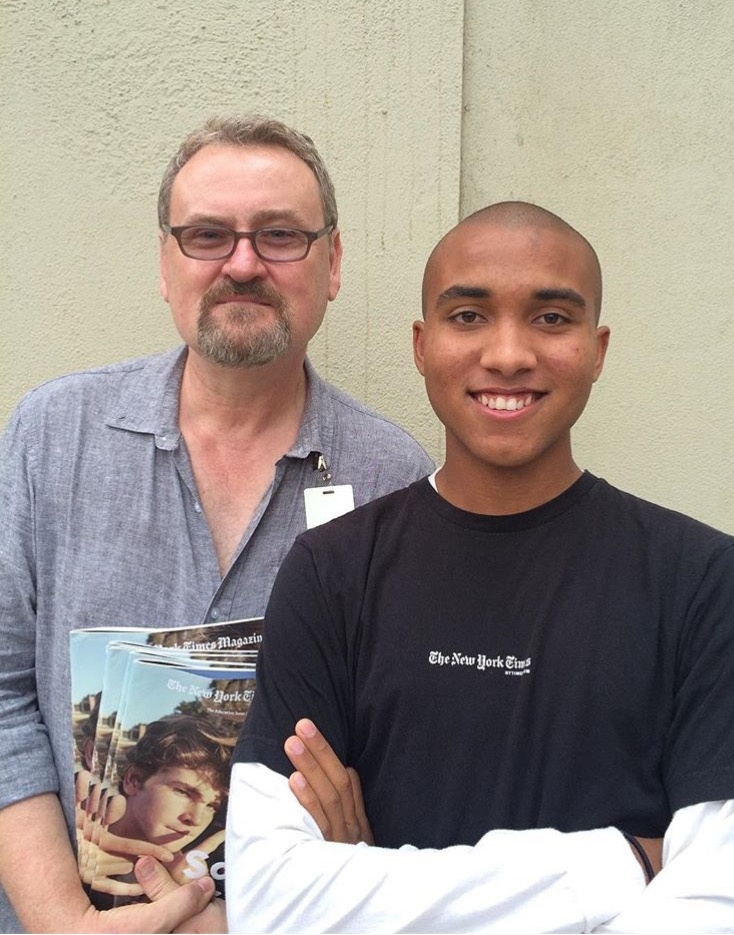 Nico Young with his photography teacher Martin Ledford. Ledford is holding copies of The New York Magazine with Young's photo spread
